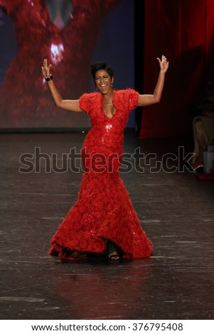 NEW YORK, NY - FEBRUARY 11: Tamron Hall walks the runway at The American Heart Association's Go Red For Women Red Dress Collection 2016 Presented By Macy's on February 11, 2016 in NYC.