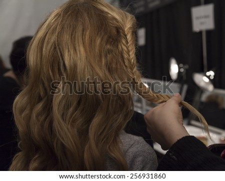 NEW YORK, NY - FEBRUARY 12, 2015: Young girl prepares backstage for Kids Rock by Nike Levi's during Fall 2015 Fashion Week at Lincoln Center - stock photo