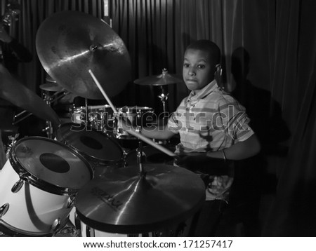 NEW YORK, NY - JANUARY 10, 2014: Antoine Roney trio including Kojo Roney 9-year old prodigy performs on stage as part of New York City Winter Jazz Festival at Zinc Bar