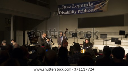 New York, NY - January 14, 2016: Wynton Marsalis, Joe Farnsworth, Christian MacBride play at charity concert Jazz Legends for Disability Pride during Winter Jazz festival & Quaker Friends Meeting Hall