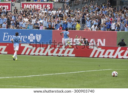 New York, NY - July 26, 2015: David Villa (7) of NYCFC celebrates goal during game between New York City Football Club and Orlando City SC at Yankee Stadium - stock photo