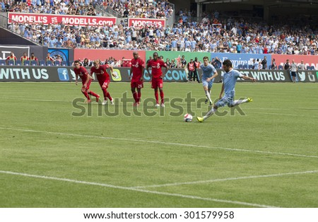 New York, NY - July 12, 2015: David Villa performs penalty kick during game between New York City FC and Toronto FC at Yankee Stadium - stock photo