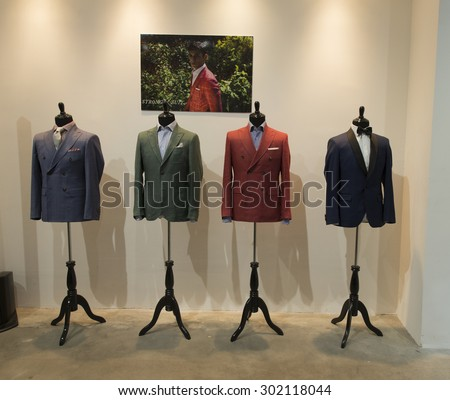 New York, NY - July 20, 2015: mens suits on display at Strong Suit Made to Measure pop up store opening  in Meatpacking district - stock photo