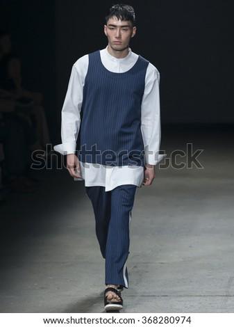 NEW YORK, NY - JULY 14, 2015: Noma Han walks the runway during the Concept Korea show at New York Fashion Week Men's S/S 2016 at Skylight Clarkson Sq - stock photo