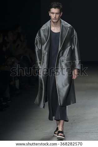 NEW YORK, NY - JULY 14, 2015: Oli Lacey walks the runway during the Concept Korea show at New York Fashion Week Men's S/S 2016 at Skylight Clarkson Sq - stock photo