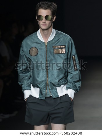 NEW YORK, NY - JULY 14, 2015: Philip Witts walks the runway during the Concept Korea show at New York Fashion Week Men's S/S 2016 at Skylight Clarkson Sq - stock photo