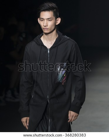 NEW YORK, NY - JULY 14, 2015: Sup Park walks the runway during the DBYD - Concept Korea show at New York Fashion Week Men's S/S 2016 at Skylight Clarkson Sq