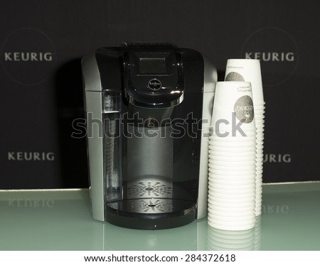 New York, NY - June 04, 2015: Keurig coffee machine on display during premiere DUKALEâ??S DREAM documentary at SVA theater in Manhattan - stock photo