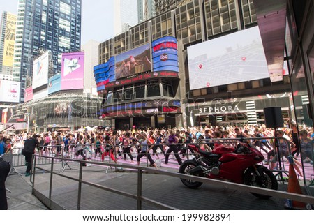 NEW YORK, NY - JUNE 21:  New Yorkers are marking the first day of summer by practicing Yoga in Times Square during the 12th annual Solstice in Times Square on June 21, 2014 in New York City.
