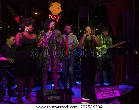 NEW YORK, NY - JUNE 30, 2014: Phyre Hawkins, Jennifer Fouche, Solomon Kee, Marisha Wallace perform at Broadway Sings For Pride benefit concert at Toshi's Living Room at The Flatiron Hotel