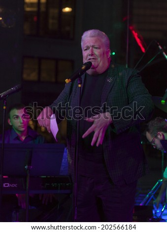 NEW YORK, NY - JUNE 30, 2014: Tym Moss speaks at Broadway Sings For Pride benefit concert at Toshi's Living Room at The Flatiron Hotel