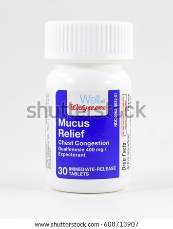 NEW YORK, NY - MARCH 19, 2017: Pill bottle of Well at Walgreens brand mucus relief medicine - isolated (white background)