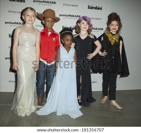 New York, NY - March 08, 2014: Young children models as Taylor Swift, Pharell Williams, Lupita Nyong'o, Kelly Osbourne, Cyndi Lauper attend Vogue Bambini petiteParade Kids Fashion Week at Center 545