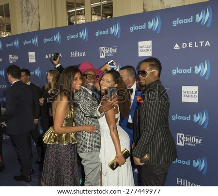 New York, NY - May 9, 2015: B.O.R.N. to Style cast creates selfie on blue carpet at 26th Annual GLAAD Media Awards at Waldorf Astoria
