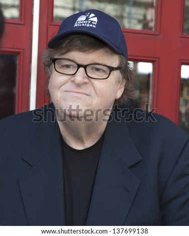 NEW YORK, NY - MAY 07: Documentary filmmaker Michael Moore attends The DCTV Cinema Groundbreaking Ceremony at DCTV on May 7, 2013 in New York City. - stock photo