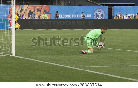 New York, NY - May 30, 2015: Houston Dynamo Goalkeeper Tyler Deric saves ball during the game between New York City Football Club and Houston Dynamo at Yankee Stadium - stock photo