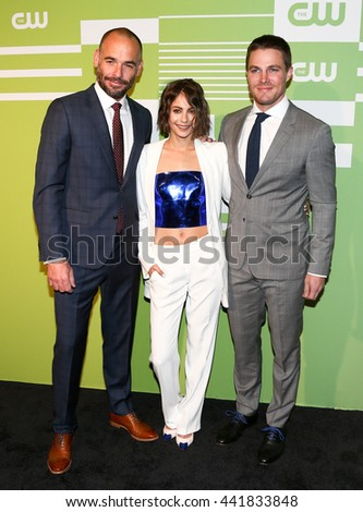 NEW YORK, NY - MAY 14: (L-R) Actors Paul Blackthorne, Willa Holland and Stephen Amell attend the 2015 CW Network Upfront Presentation at the London Hotel on May 14, 2015 in New York City. - stock photo