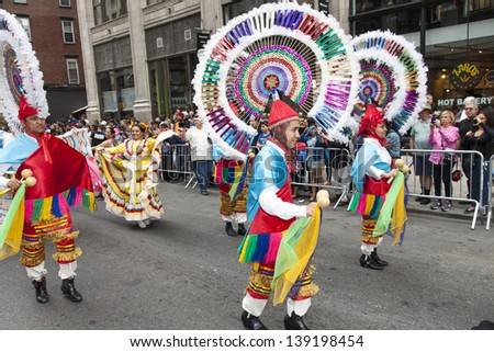 NEW YORK, NY - MAY 18: Members of Mazarte Dance Group dances on Broadway during 7th Dance Parade of New York on May 18, 2013 in New York City.