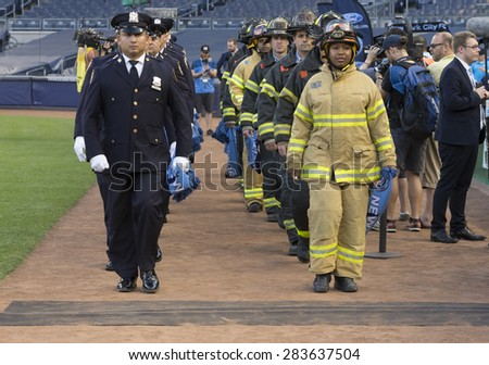 New York, NY - May 30, 2015: NYPD police officers and NYFD firefighters attend the game between New York City Football Club and Houston Dynamo at Yankee Stadium - stock photo