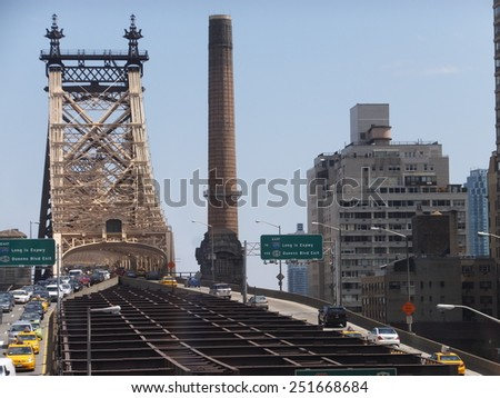 NEW YORK, NY - MAY 3: Queensboro Bridge in New York, as seen on May 3, 2014. Queensboro Bridge in New York. It is the connection between Roosevelt Island and East Side Manhattan. - stock photo