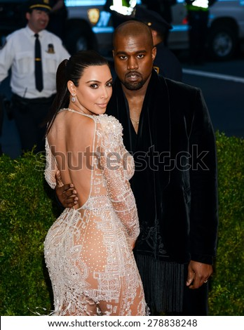 New York, NY  Monday May 04, 2015: Kim Kardashian and Kanye West attend 'China: Through The Looking Glass' Costume Institute Gala, held at the Metropolitan Museum of Art in New York City, New York. - stock photo