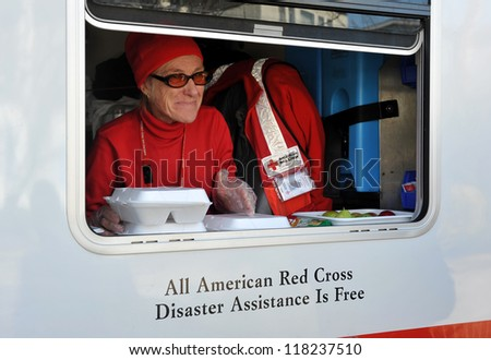 NEW YORK, NY - NOVEMBER 09:  A mobile Red Cross unit supplies hot lunches for local people in the Breezy Point part of Far Rockaway on November 9, 2012 in the Queens borough of New York City.