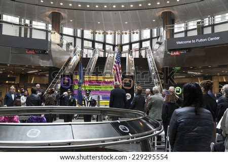 New York, NY - November 9, 2014: Atmosphere during National Anthem sang at opening ceremony of Fulton Center unveiled by Metropolitan Transit Authority during opening ceremony on Broadway in Manhattan
