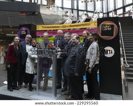 New York, NY - November 9, 2014: Cutting ribbon during opening ceremony of Fulton Center unveiled by Metropolitan Transit Authority during opening ceremony on Broadway in Manhattan - stock photo