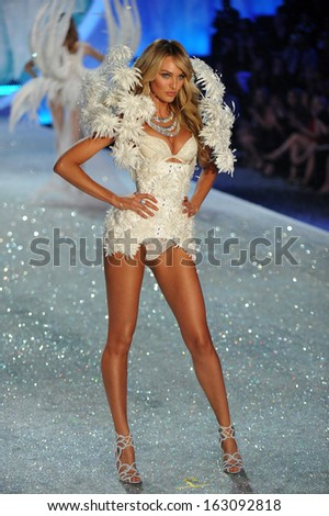 NEW YORK, NY - NOVEMBER 13: Model Candice Swanepoel walks the runway at the 2013 Victoria's Secret Fashion Show at Lexington Avenue Armory on November 13, 2013 in New York City.  - stock photo