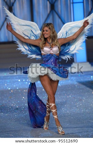 NEW YORK, NY - NOVEMBER 09: Model Doutzen Kroes walks the runway during the 2011 Victoria's Secret Fashion Show at the Lexington Avenue Armory on November 9, 2011 in New York City. - stock photo