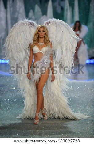 NEW YORK, NY - NOVEMBER 13: Model Lily Donaldson walks the runway at the 2013 Victoria's Secret Fashion Show at Lexington Avenue Armory on November 13, 2013 in New York City. - stock photo