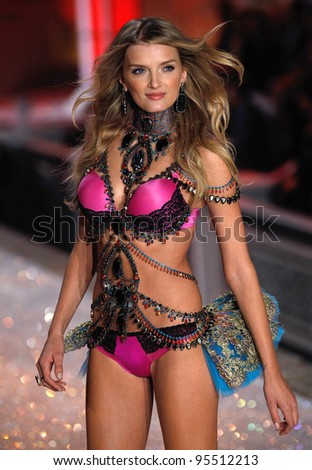 NEW YORK, NY - NOVEMBER 09: Model Lily Donaldson walks the runway during the 2011 Victoria's Secret Fashion Show at the Lexington Avenue Armory on November 9, 2011 in New York City.