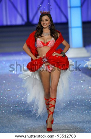 NEW YORK, NY - NOVEMBER 09: Model Miranda Kerr walks the runway during the 2011 Victoria's Secret Fashion Show at the Lexington Avenue Armory on November 9, 2011 in New York City. - stock photo