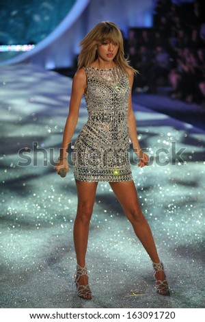 NEW YORK, NY - NOVEMBER 13: Singer Taylor Swift performs at the 2013 Victoria's Secret Fashion Show at Lexington Avenue Armory on November 13, 2013 in New York City. - stock photo