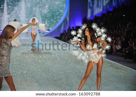 NEW YORK, NY - NOVEMBER 13: Singer Taylor Swift performs (L) and model Lily Aldridge walks the runway at the 2013 Victoria's Secret Fashion Show on November 13, 2013 in New York City.  - stock photo