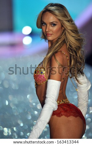 NEW YORK, NY - NOVEMBER 13: The first model out Candice Swanepoel walks in the 2013 Victoria's Secret Fashion Show on November 13, 2013 in New York City.  - stock photo