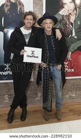 New York, NY - NOVEMBER 07, 2014: Thomas Adams and Cody Simpson attend OnePiece New York Concept Store Grand Opening In SOHO on Broadway