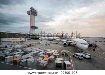 NEW YORK, NY - OCT 23, 2013: Early morning at JFK International Airport as cargo boxes are scattered readied for airlines. - stock photo