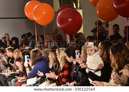 NEW YORK, NY - OCTOBER 17: A guests crowd  at Martin Morgan Fall/Winter 2016 Runway Show during petiteParade at The Spring Stdio on October 17, 2015 in NYC.  - stock photo