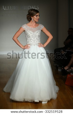 NEW YORK, NY - OCTOBER 11: A model walks at Allure Bridals Fall/Winter 2016 Runway Show at The Metropolitan pavilion on October 11, 2015 in NYC. - stock photo