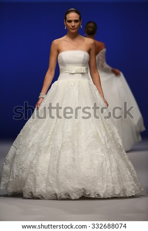 NEW YORK, NY - OCTOBER 10: A model walks at Giovanni Alessandro Bridal Fall/Winter 2016 Runway Show at The Pier94 on October 10, 2015 in New York City. - stock photo