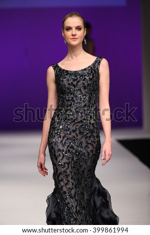 NEW YORK, NY - OCTOBER 11: A model walks at Mon Cheri Bridal Fall/Winter 2016 Runway Show at The Pier 94 on October 11, 2015 in New York City.