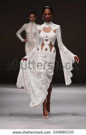 NEW YORK, NY - OCTOBER 10: A model walks at Oved Cohen Bridal Fall/Winter 2016 Runway Show at The Pier 94 on October 10, 2015 in New York City. - stock photo