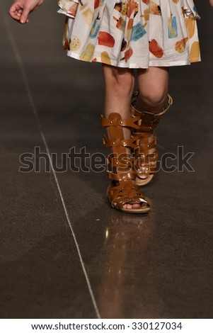 NEW YORK, NY - OCTOBER 17: A model walks runway at Martin Morgan Fall/Winter 2016 Runway Show during petiteParade at The Spring Studio on October 17, 2015 in NYC.  - stock photo