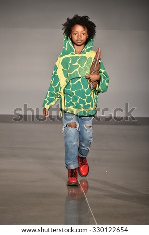 NEW YORK, NY - OCTOBER 17: A model walks runway at The New School Parsons Fall/Winter 2016 Runway Show during petiteParade at The Spring Studio on October 17, 2015 in NYC. - stock photo