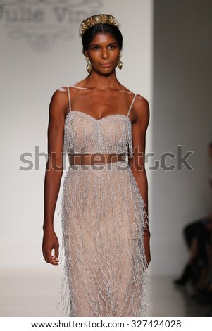 NEW YORK, NY - OCTOBER 10: A model walks runway during the Julie Vino Bridal Fall/Winter 2016 Presentation at EZ Studio on October 10, 2015 in NYC. - stock photo