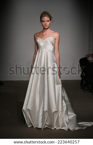 NEW YORK, NY - OCTOBER 12: A model walks the runway at the Anna Maier / Ulla-Maija Couture Fall 2014 Bridal collection show at the Hilton New York on October 12, 2014 in New York City.