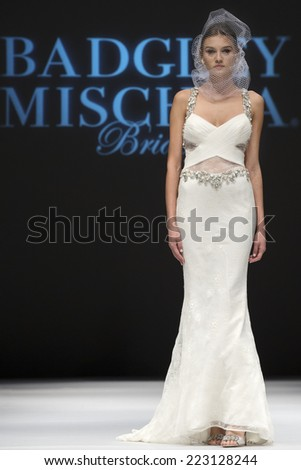 NEW YORK, NY - OCTOBER 11, 2014: A model walks the runway at the Badgley Mischka Runway Show during Fall 2015 Bridal Collection at Pier 94- Fashion Theater - stock photo