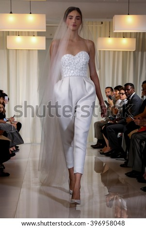 NEW YORK, NY - OCTOBER 08: A model walks the runway during the Angel Sanchez Bridal Fall/Winter 2016 Runway Show on October 8, 2015 in New York City. - stock photo