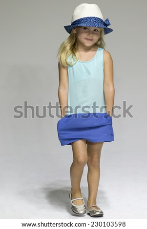 NEW YORK, NY - OCTOBER 18, 2014: A model walks the runway during the Chloe preview at petitePARADE - Kids Fashion Week at Bathhouse Studios - stock photo